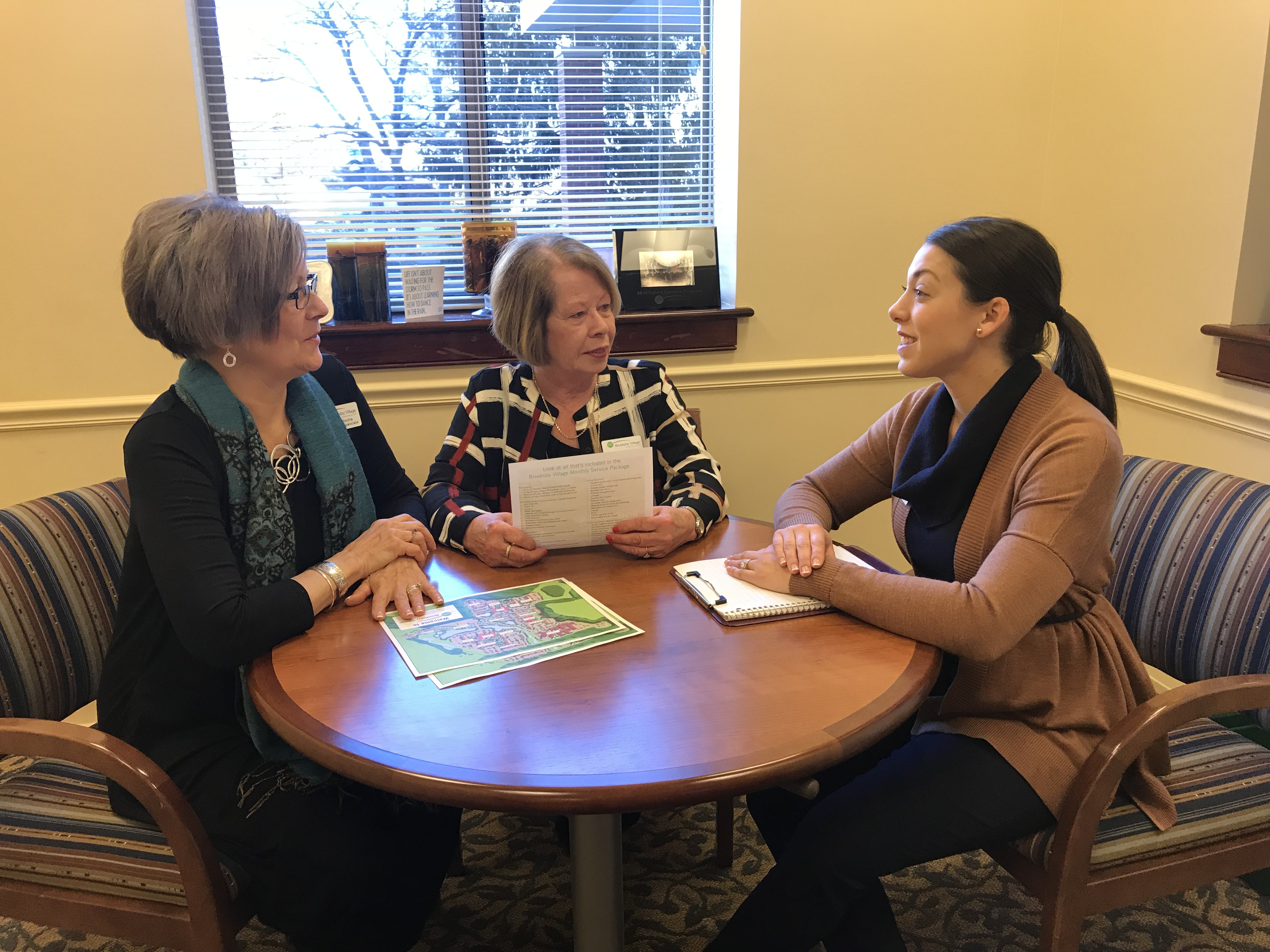 From left to right; Diane DeRoche, Senior Sales Associate, Brooksby Village; Barbara Nunes, Sales Associate, Brooksby Village meeting with Gina Fernandez, Sales Manager, Brooksby Village to discuss all the appointments for the day in the Sales Office.